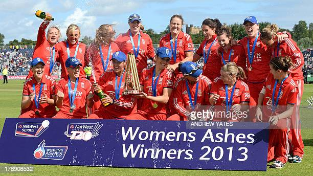 England's women cricket team pose for pictures with the Ashes trophy after winning the Women's International Twenty20 cricket between England and...