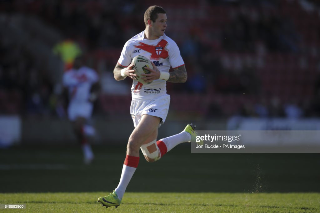England's Zak Hardaker scores a try during the Autumn International at the Racecourse Ground, Wrexham.