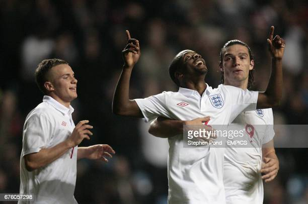 England's Zavon Hines celebrates scoring with team mate Tom Cleverley and Andy Carroll