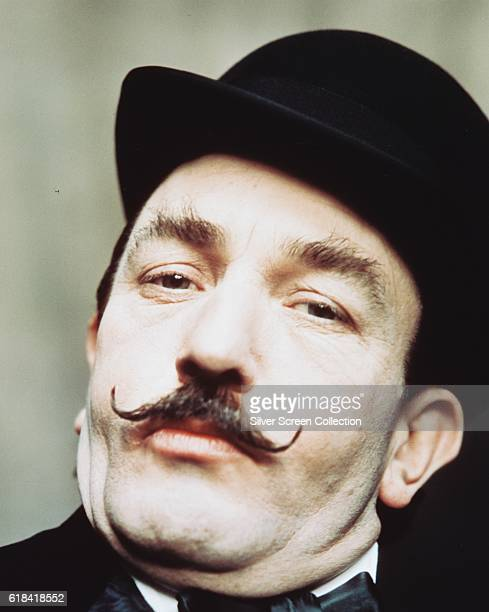 English actor Albert Finney as Belgian detective Hercule Poirot in the British mystery film 'Murder on the Orient Express' 1974 The film was based on...