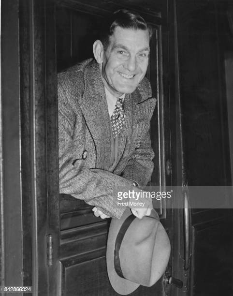 English actor and comedian Will Hay leaves King's Cross Station in London for a holiday in Norway 20th July 1946 He suffered a stroke earlier that...