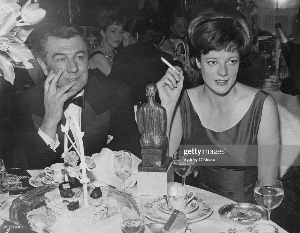 English actor and director Michael Redgrave (1908 - 1985) with English actress Maggie Smith at the Evening Standard theatre awards at the Savoy Hotel, London, 29th January 1963. Smith won the award for Best Actress for her performances in Peter Shaffer's one-act plays, 'The Private Ear' and 'The Public Eye'.