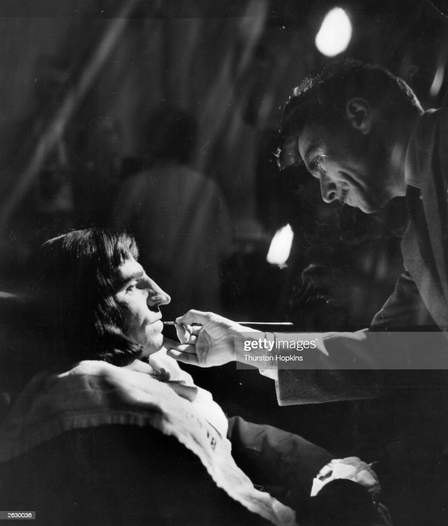 English actor and director Sir Laurence Olivier (1907 - 1989) being made up for his role as the Duke of Gloucester in the London Films version of Shakespeare's 'Richard III', which he is directing at Shepperton Studios. Original Publication: Picture Post - 7483 - Four Knights In One Film - pub. 1955
