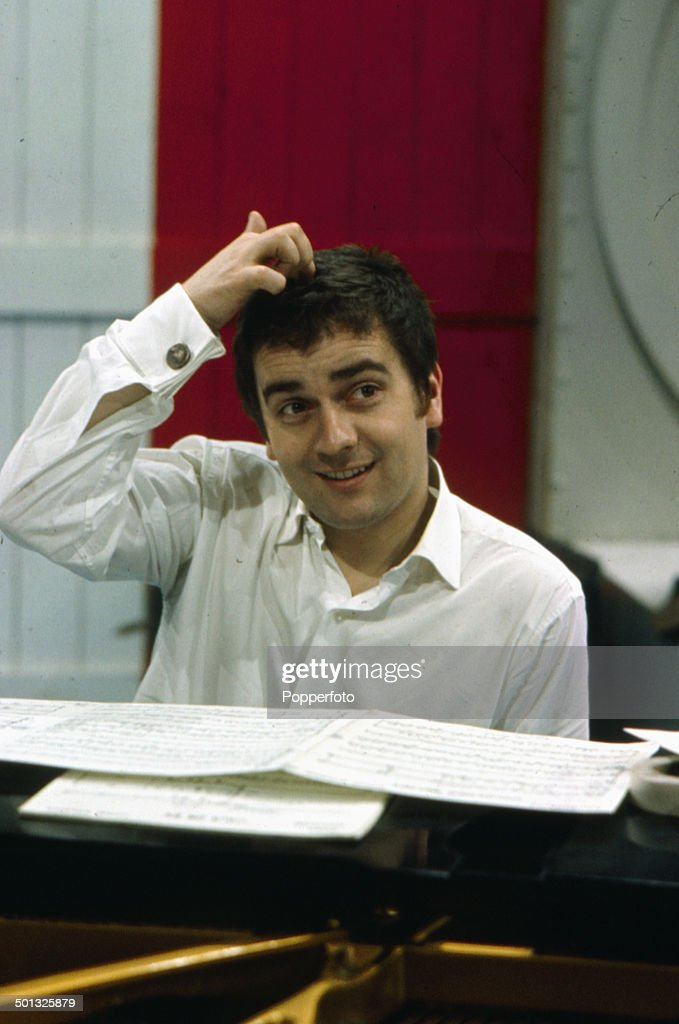 English actor and musician Dudley Moore (1935-2002) pictured at a piano in rehearsal in 1966.