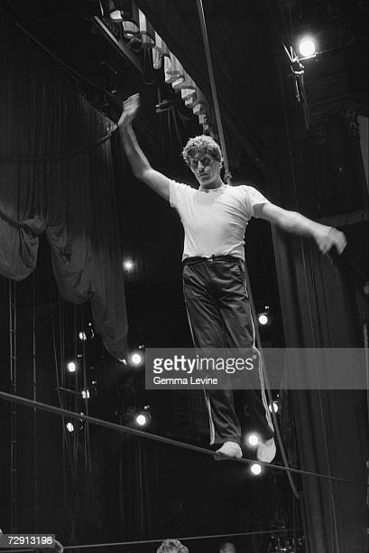 English actor and singer Michael Crawford walks the tightrope during a rehearsal for a BBC production of the musical 'Barnum' circa 1986