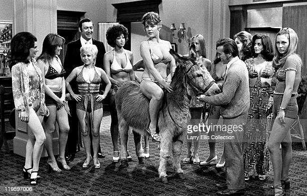 English actor Bernard Bresslaw and actresses Wendy Richard and Barbara Windsor help orchestrate a beauty contest in the film 'Carry On Girls' 1973...