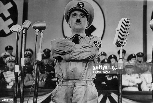 English actor Charlie Chaplin directs and stars in the film 'The Great Dictator'