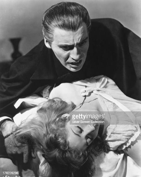 English actor Christopher Lee as the vampire Count Dracula and Scottish actress Melissa Stribling as Mina Holmwood in 'Dracula' directed by Terence...