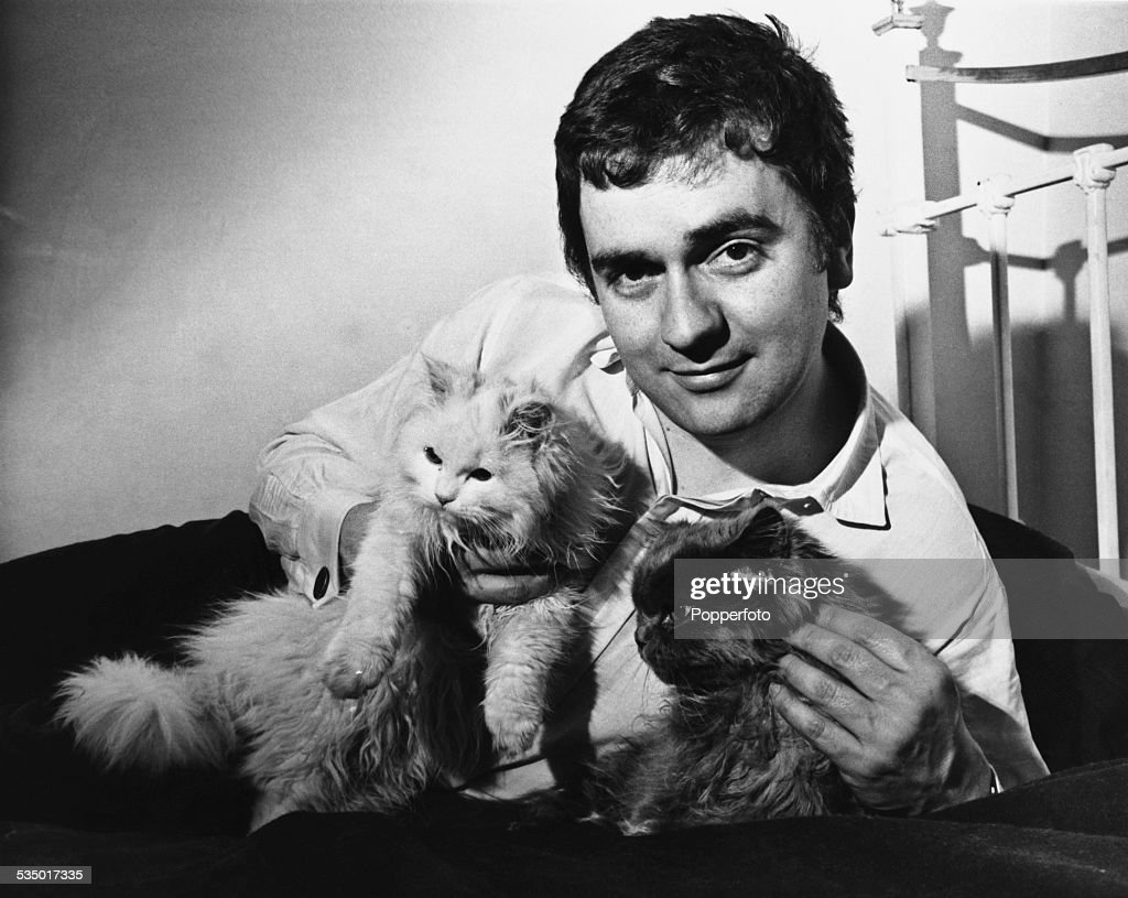 English actor, comedian, and musician <a gi-track='captionPersonalityLinkClicked' href=/galleries/search?phrase=Dudley+Moore&family=editorial&specificpeople=209351 ng-click='$event.stopPropagation()'>Dudley Moore</a> (1935 - 2002) with two cats, 1966.