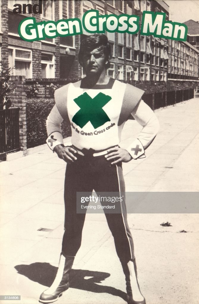 English actor Dave Prowse as the dGreen Cross Manf for a road safety campaign aimed at children promoting 'The Green Cross Code'.