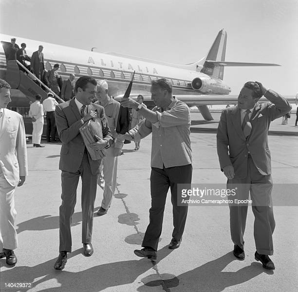 English actor Dirk Bogarde with Joseph Losey at the airport Lido Venice 1960s