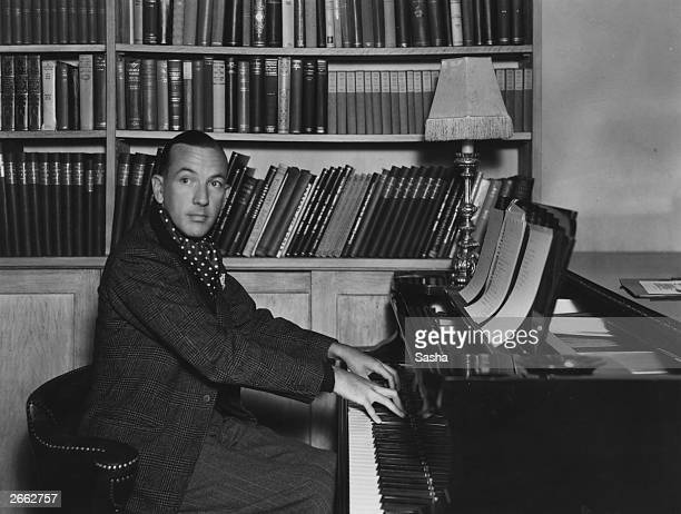 English actor dramatist and composer Noel Coward playing the piano at home Original Publication People Disc HC0459