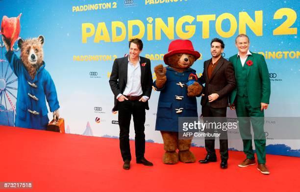 English actor Hugh Grant Paddington Austrian dubbing actor Elyas M'Barek and English actor Hugh Bonneville pose during a red carpet event for the...