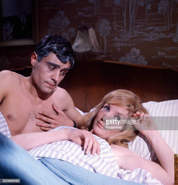 English actor Ian McShane pictured in bed with the actress Elizabeth Weaver in a scene from the television drama 'You Can't Win' in 1966