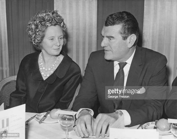 English actor Jack Hawkins with Mary Wilson the wife of Prime Minister Harold Wilson during a Variety Club of Great Britain luncheon at the Savoy...
