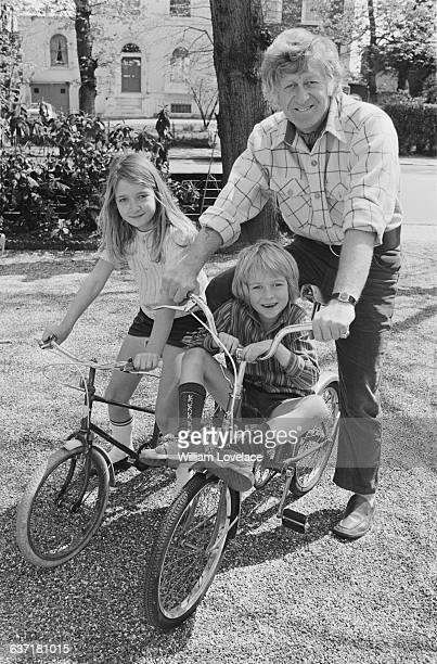 English actor Jon Pertwee and his son Sean and daughter Dariel cycling near their home in Barnes London UK 2nd May 1971
