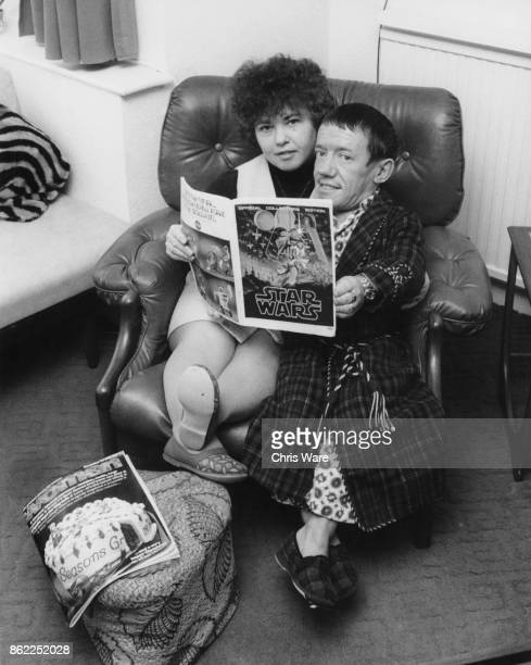 English actor Kenny Baker famed for his role as R2D2 in the film 'Star Wars' with his wife Eileen at their home in Bushy London circa 1977 They are...