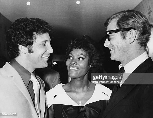 English actor Michael Caine and American singer Dionne Warwick congratulate Welsh singer Tom Jones after his opening performance of a residency in...