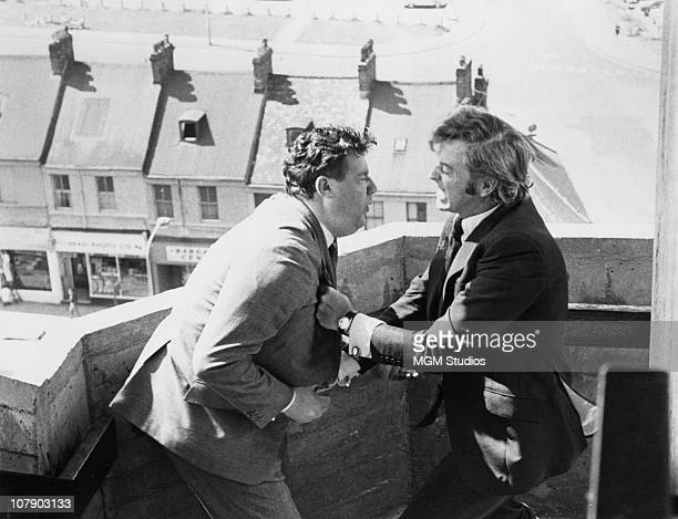 English actor Michael Caine tackles Bryan Mosley in a scene from Mike Hodges' thriller 'Get Carter' 1970