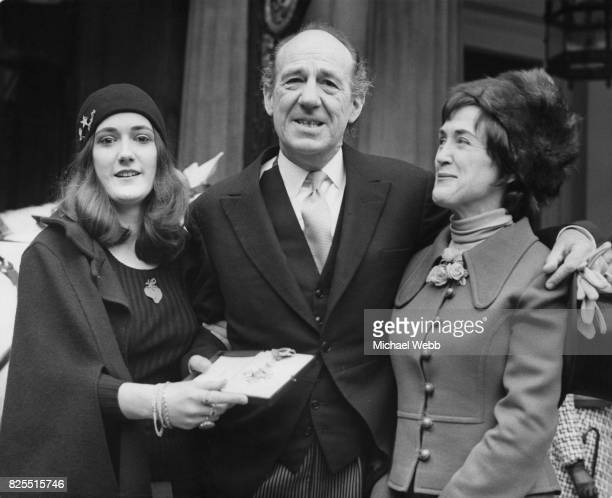 English actor Michael Hordern with his wife Eve and daughter Joanna after receiving a CBE from the Queen Mother at Buckingham Palace London 15th...