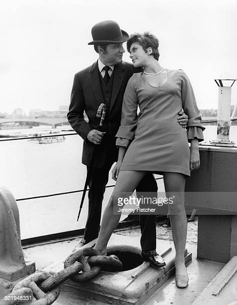 English actor Patrick Macnee and Canadian actress Linda Thorson on a boat moored on the River Thames in London during a publicity photoshoot for the...