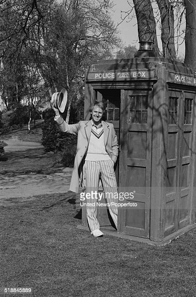 English actor Peter Davison pictured in character as The Doctor from the BBC television science fiction series Doctor Who standing at the door of the...