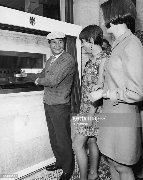 English actor Reg Varney makes the first withdrawal from a Barclaycash machine at the Enfield branch of Barclays Bank 27th June 1967 The Enfield...