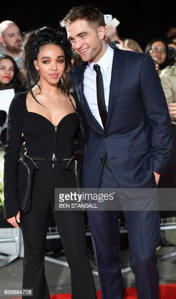 English actor Robert Pattinson and English singer Tahliah Debrett Barnett also known as FKA Twigs pose upon arrival at the UK premiere of the film...