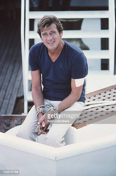 English actor Roger Moore as 007 on the set of the James Bond film 'For Your Eyes Only' February 1981 Here his hands are tied in readiness for a...
