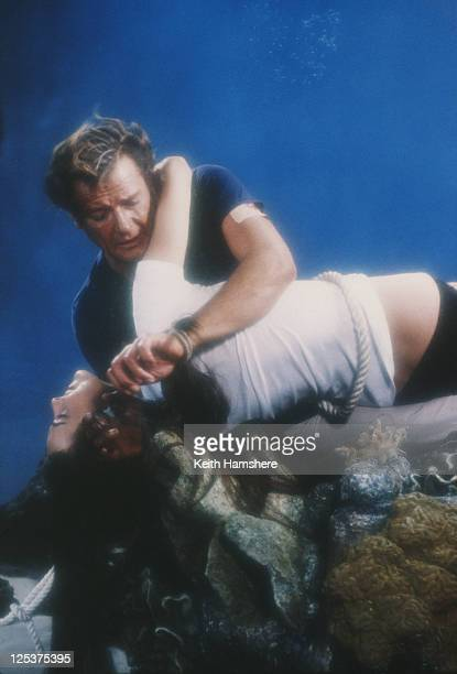 English actor Roger Moore as 007 with French actress Carole Bouquet as Melina Havelock on the set of the James Bond film 'For Your Eyes Only' 1981 In...