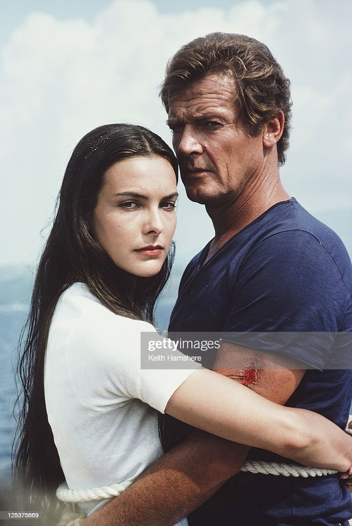 English actor <a gi-track='captionPersonalityLinkClicked' href=/galleries/search?phrase=Roger+Moore+-+Actor&family=editorial&specificpeople=160468 ng-click='$event.stopPropagation()'>Roger Moore</a> as 007 with French actress <a gi-track='captionPersonalityLinkClicked' href=/galleries/search?phrase=Carole+Bouquet&family=editorial&specificpeople=208685 ng-click='$event.stopPropagation()'>Carole Bouquet</a> as Melina Havelock on the set of the James Bond film 'For Your Eyes Only', March 1981. Here they are tied together in readiness for a scene in which they are dragged through shark-infested waters.