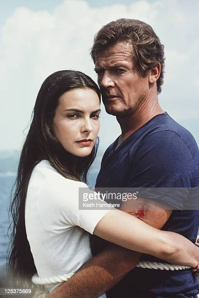 English actor Roger Moore as 007 with French actress Carole Bouquet as Melina Havelock on the set of the James Bond film 'For Your Eyes Only' March...