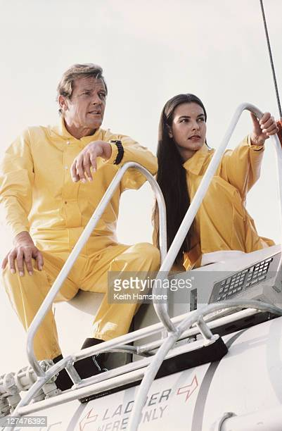 English actor Roger Moore as 007 with French actress Carole Bouquet as Melina Havelock on the set of the James Bond film 'For Your Eyes Only' 1981...