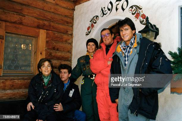 English actor Roger Moore is on vacation with his family in Gstaad Switzerland Right to left are son Geoffrey Roger Luisa Mattioli son Christian and...