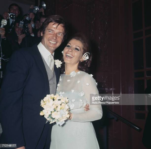 English actor Roger Moore pictured with his new wife Italian actress Luisa Mattioli on their wedding day outside Caxton Hall in London on 11th April...