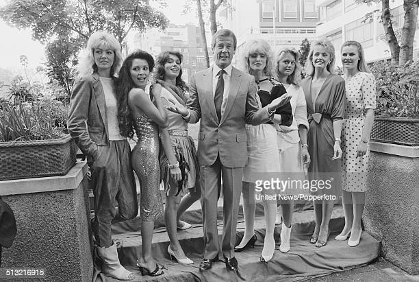 English actor Roger Moore posed with Bond girls Joni Flynn Janine Andrews Carole Ashby Carolyn Seaward Alison Worth Mary Stavin and Tina Robinson at...