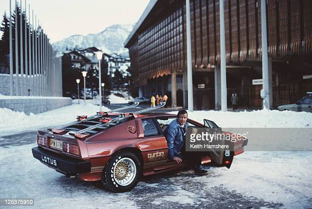 English actor Roger Moore poses as 007 with a Lotus Esprit Turbo on the set of the James Bond film 'For Your Eyes Only' in Cortina d'Ampezzo Italy...