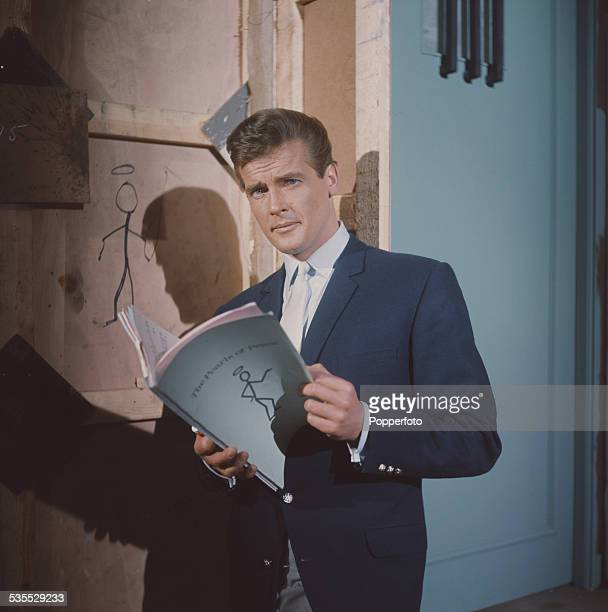 English actor Roger Moore who plays Simon Templar in the television series 'The Saint' pictured holding a script for The Pearls Of Peace episode at...