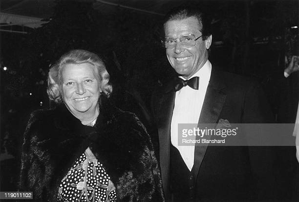 English actor Roger Moore with AnneMarie Dupuy the Mayor of Cannes circa 1985