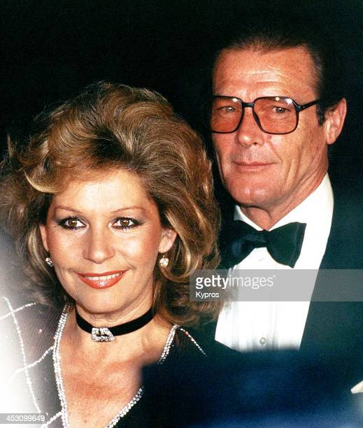 English actor Roger Moore with his wife Luisa circa 1990