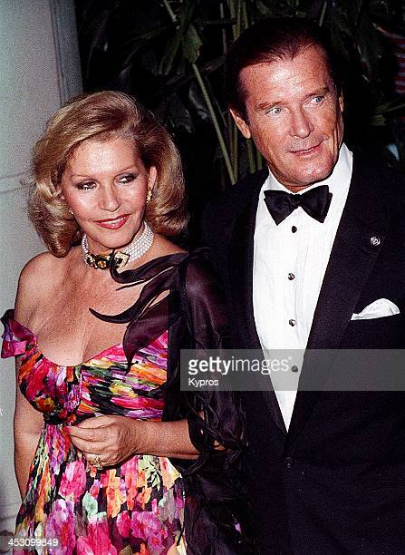 English actor Roger Moore with his wife Luisa circa 1992