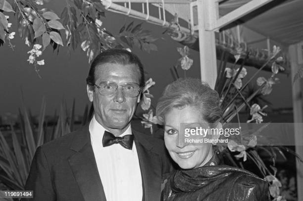 English actor Roger Moore with his wife Luisa Mattioli at the Cannes Film Festival France circa 1988