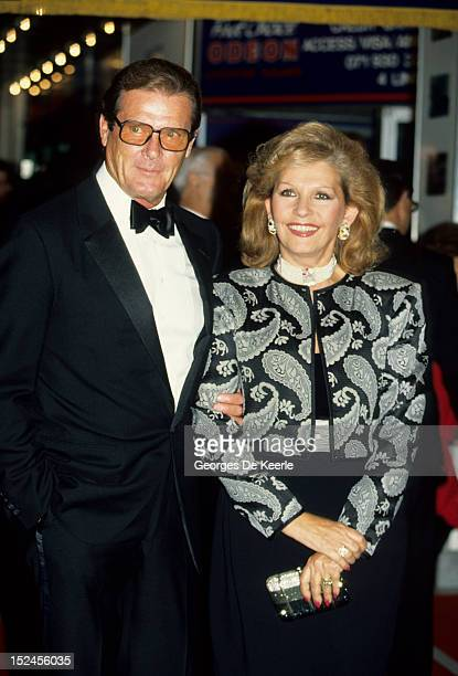 English actor Roger Moore with his wife Luisa Mattioli attend a premiere at the Odeon Cinema in London 1988 circa