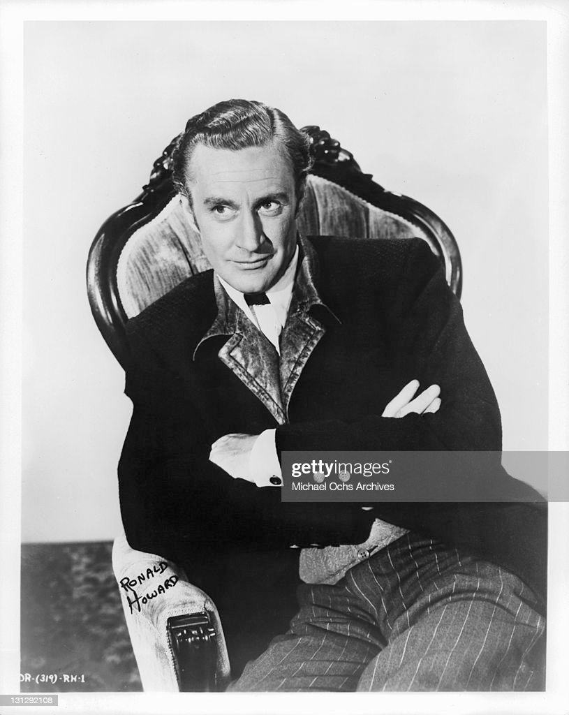 Leslie Howard with arms folded and sitting in a scene from the film 'Gone With The Wind' 1939