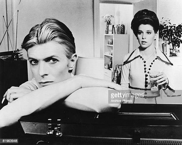 English actor singer and musician David Bowie stars with Candy Clark in 'The Man Who Fell to Earth' 1976