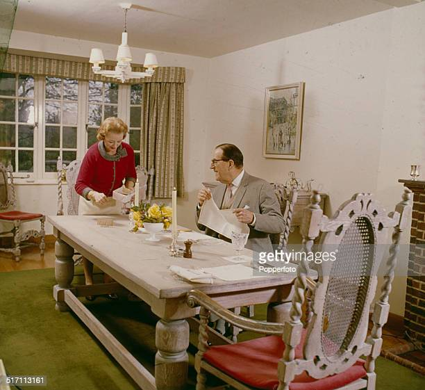 English Actor Stanley Holloway Pictured With His Wife Violet Lane In Their Dining Room At Home