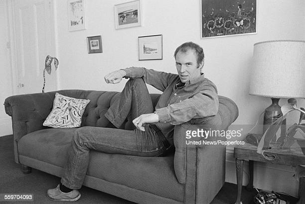 English actor Tim PigottSmith pictured sitting on a sofa at home in Highgate London on 8th February 1984