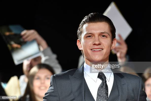 English actor Tom Holland poses upon arrival at the UK premiere of the film 'The Lost City Of Z' at The British Museum in London on February 16 2017...