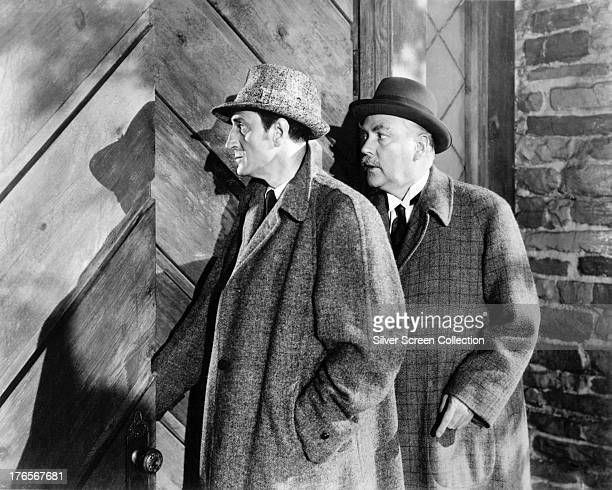 English actors Basil Rathbone as Sherlock Holmes and Nigel Bruce as Dr Watson in 'The Adventures of Sherlock Holmes' directed by Alfred L Werker 1939