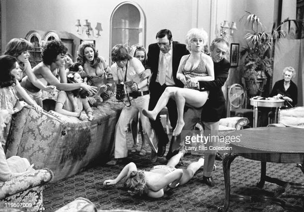 English actors Bernard Bresslaw Robin Askwith and Sid James try and separate feuding actresses Margaret Nolan and Barbara Windsor in the film 'Carry...